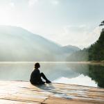Sitting alone by a lake